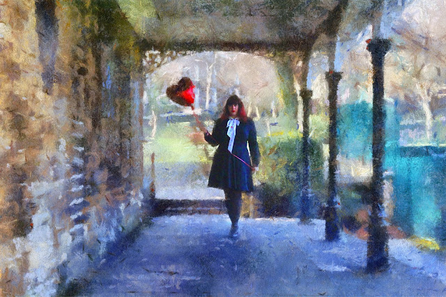 Big Fashionista wearing a Black Dress carrying a red heart shaped balloon