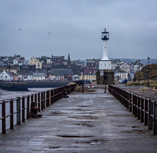 Photo of Maryport lighthouse with the town in the distance through the mist