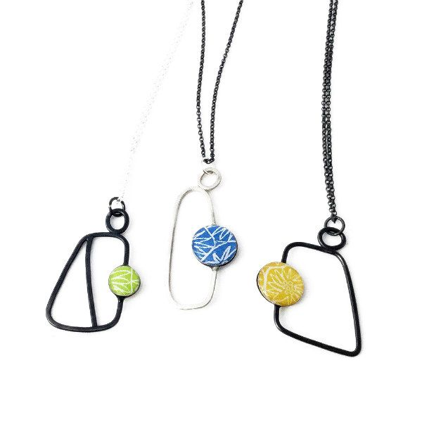 Handmade pendants feature printed card and resin beads on sterling silver geo shapes with necklace chains