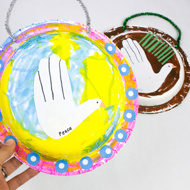 How to Make Easy Handprint Christmas Dove Art using Paper plates- such a sweet Christmas craft for kids