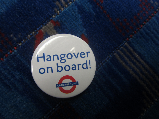 Photograph of badge with writing Hangover On Board and the London Underground logo