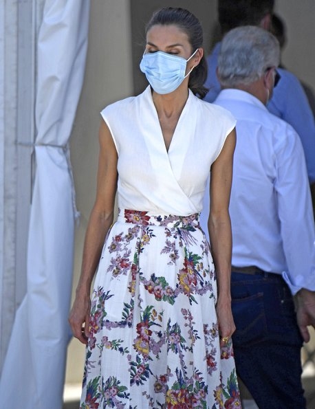 Queen Letizia wore a girasol cotton blend skirt by Sweet Matitos, and a draped linen top by Zara, and an espadrille wedges by Macarena