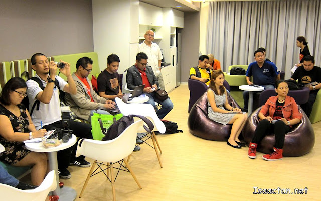 Awesome bloggers and friends listening intently to the speech by Ms Cheng