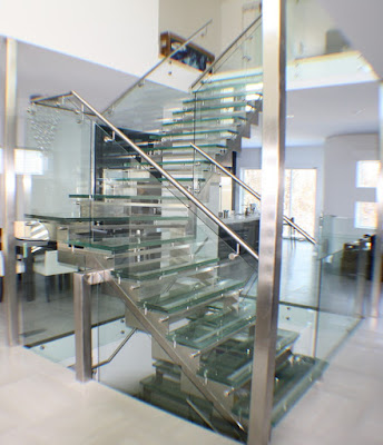 The railing of the stairs made of tempered glass