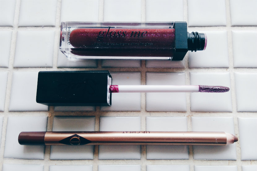 Sleek Gloss Me in Phoenix Rising; Charlotte Tilbury Lip Cheat in Foxy Brown