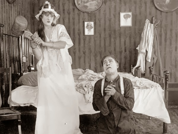 Motion picture scene, 1916.  Ethel Burton Palmer is to the left and an unknown actor to the right. Ethel Burton (Palmer) was a popular comedic actress who made her debut with Vitagraph Pictures in 1915. She co-starred in several Billy West comedies (a popular Charlie Chaplin imitator), and was married to director Arvid Gillstrom, a Swedish-born filmmaker who directed many of the West comedies. Burton did little acting after the 1910s. Most of the films she made in Florida were with the Vim Comedy Company.
