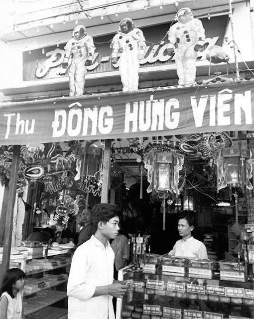 """Tết Trung Thu 1969 - """"Moon Men"""" - Tiệm bánh Phú Hương - Douglas Pike Photograph Collection."""