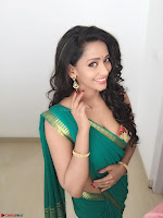 Sanjana Singh Looks Super cute in Green Saree Sleeveless Choli 4.JPG