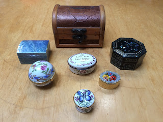 assorted decorative boxes, some enameled, some inlaid, one painted ceramic