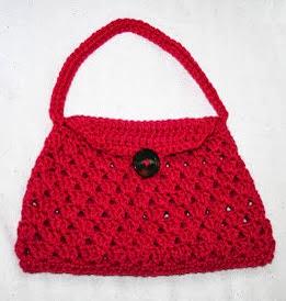 http://tampabaycrochet.blogspot.com.es/2012/03/free-pattern-stylish-crochet-handbag.html