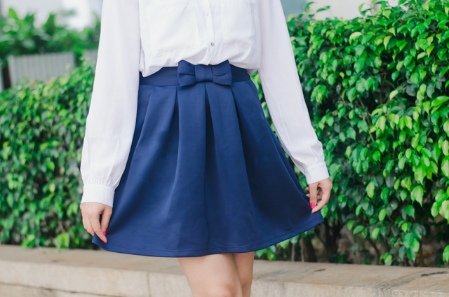 Navy blue pleated bow skirt
