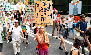 Several thousand people took part in a climate march in New York City on Thursday. Ten activists were arrested after blocking the street in front of Andrew Cuomo's Manhattan office. (Photograph Credit: Michael Brochstein/SOPA Images/REX/Shutterstock) Click to Enlarge.