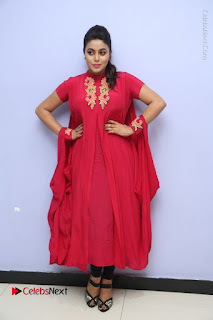 Actress Poorna Latest Stills in Red Dress at Rakshasi First Look Launch  0323.JPG