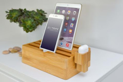 same box-like charging station as above with an attachment that holds an AirPod case