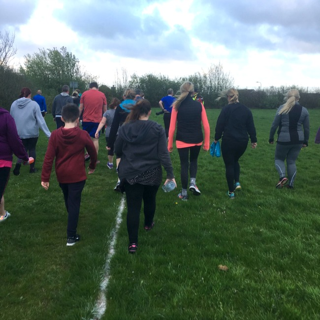 group-of-people-walking-on-grass-training-for-the-c25k-couch-to-5-k