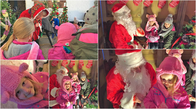Girls seeing father christmas