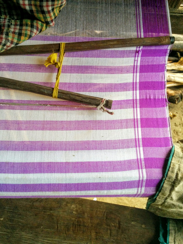 Traditional Gamcha being made in the traditional loom, Assam
