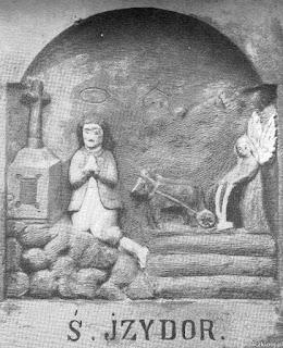 Św. Izydor. Płaskorzeźba na figurze w Sierakowie.