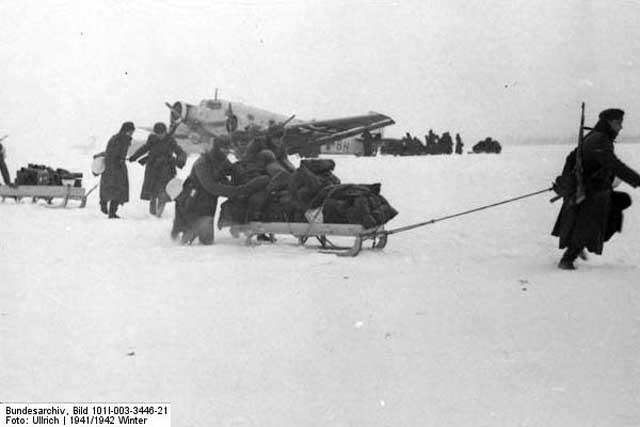 German soldiers unloading a Junkers Ju 52 in the Demyansk pocket, January 1942 Worldwartwo.filminspector.com