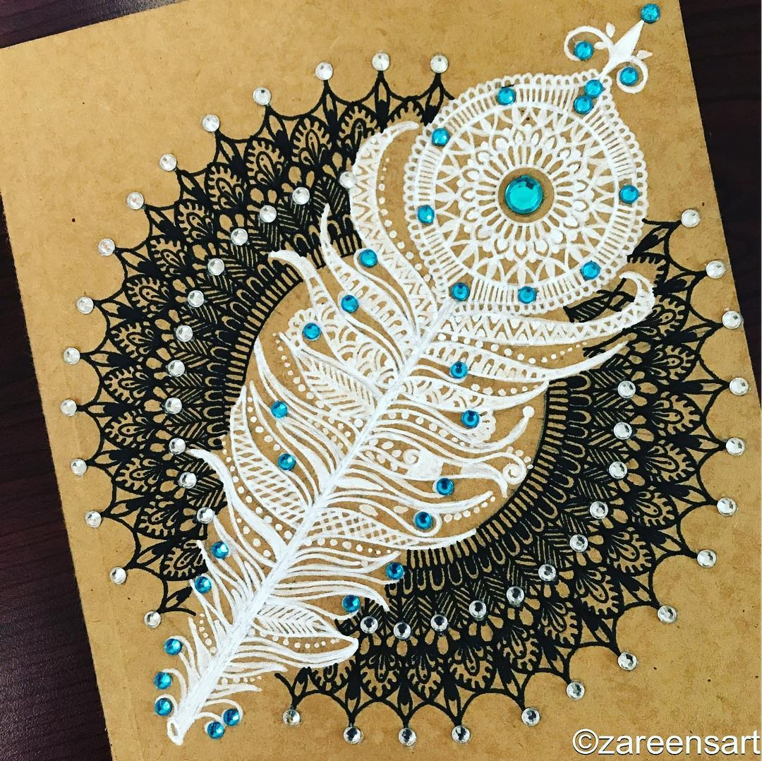 02-Feather-journal-with-crystals-Mandala-Drawings-on-Journals-Calendar-and-Boxes-www-designstack-co