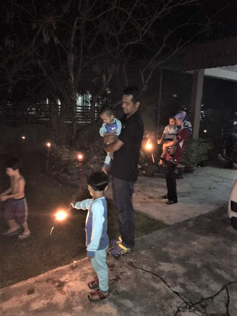 Playing Sparklers On Last Night Before Eid