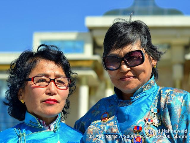 people, portrait, street portrait, double portrait, Mongolia, Ulaanbaatar, Chinggis Khaan Square, Mongolian women, traditional Mongolian costume, Mongolian deel