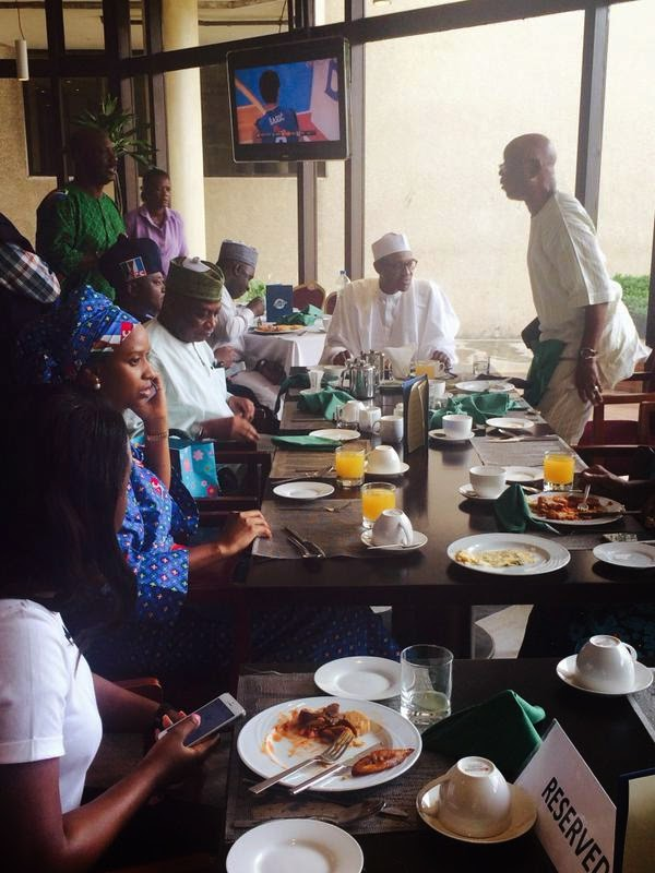 Buhari And Team Pictured Enjoying Breakfast As They Prepare For Lagos Rally