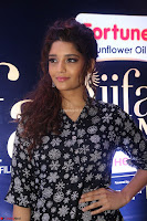 Ritika Singh in Black Printed Shirt and White Leggings at IIFA Utsavam Awards press meet 27th March 2017 13.JPG