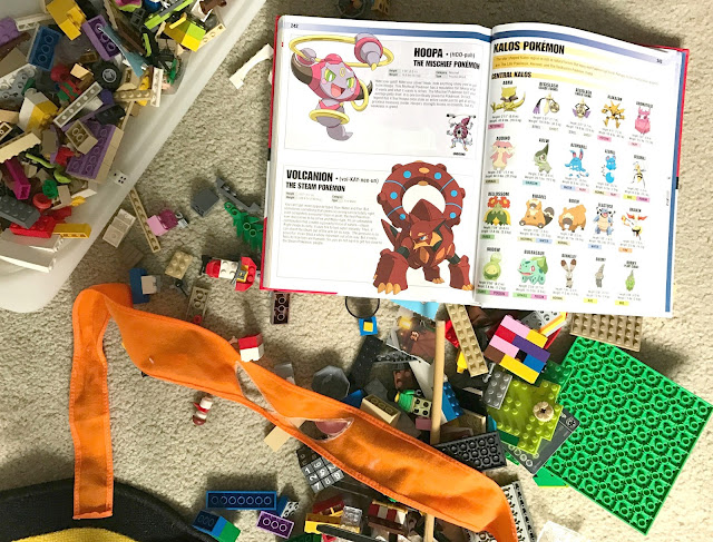 Lego, Pokemon book and super hero mask