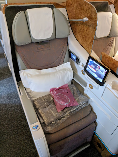 Emirates Business Class seat and amenities aboard the 777 in Dublin