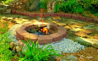 Stone firepit and flagstone patio desinged by Susan Golis