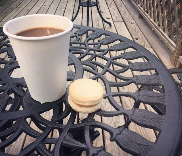 A simple cup of coffee, delicious macaron and patio vibes at Tredici Bakery  in the Capital Heights neighborhood of Baton Rouge