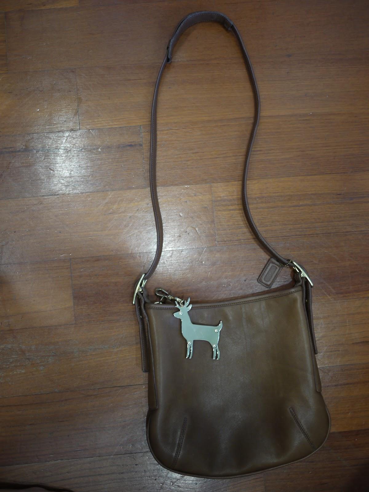 ShopaholiCouture: Vintage Coach Sling Bag