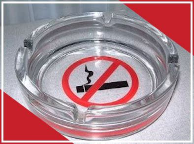 Glass ashtray with familiar 'No Smoking' icon on the base