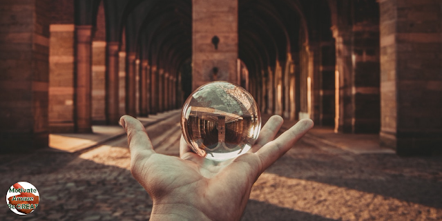 "Featured in the article: ""5 Magical Ways To Get Work Motivation And Conquer Your Goals"". Hand, magic, ball, time for yourself. Time is yours, time is in your hands."
