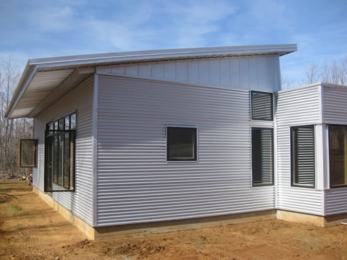 Net zero prefab house has another rainy sunny week with for Prefab sip homes