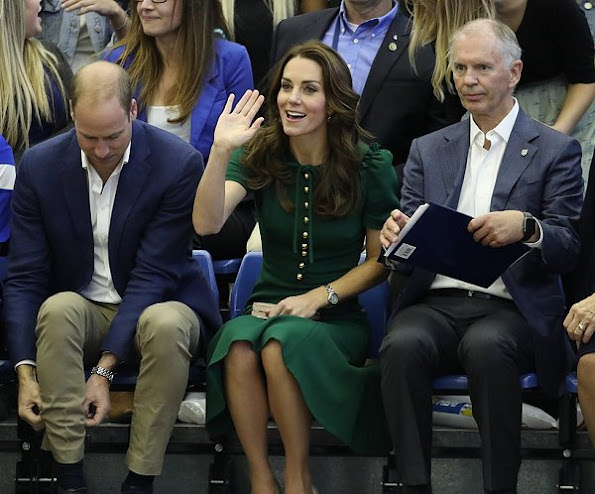 Kate Middleton wore wore Dolce & Gabbana Pocket Crepe Midi Dress, L.K. Bennett Nina Clutch, L.K. Bennett Fern Pumps. Monica Vinader Siren Wire Earrings.