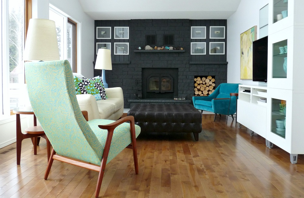Living room with grey painted fireplace