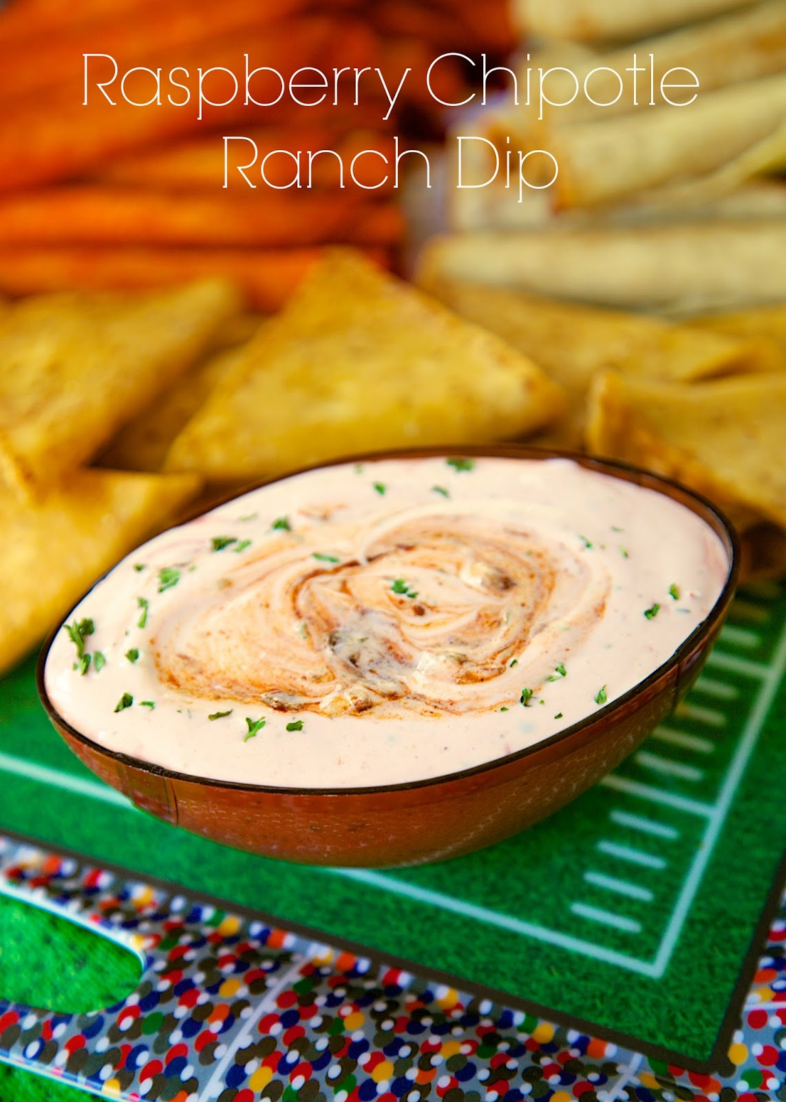 Raspberry Chipotle Ranch Dip - homemade ranch dip with raspberry jam and chipotle peppers. It packs a kick! Great with veggies, chips, taquitos. Also delicious on top of a baked potato! Simple and delicious dip recipe!