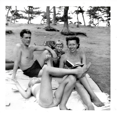 Bill Schwartz, Natalie Vasilev, and her daughters Lena and Tatiana hang out on the beach near Kamakura, Japan in 1951.