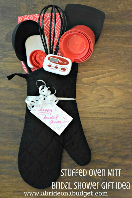 Looking for a really useful and unique bridal shower gift idea? Check out this Stuffed Oven Mitt Bridal Shower Gift Idea from www.abrideonabudget.com. It's made solely from items at Dollar Tree.