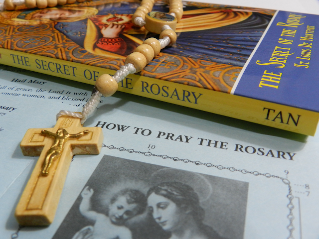 "A photo of St. Louis De Montfort's book, ""The Secret of the Rosary."""