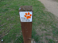 Dogs Welcome on a lead sign