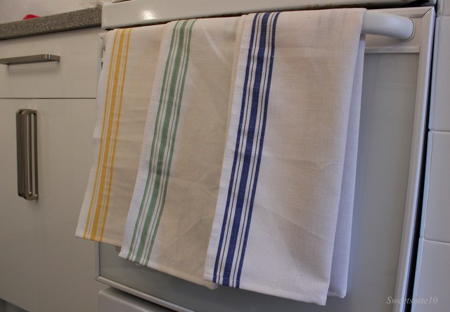 tea towels hanging on an oven