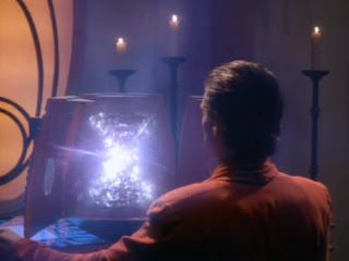 Image of Vedek Bareil staring into an Orb.
