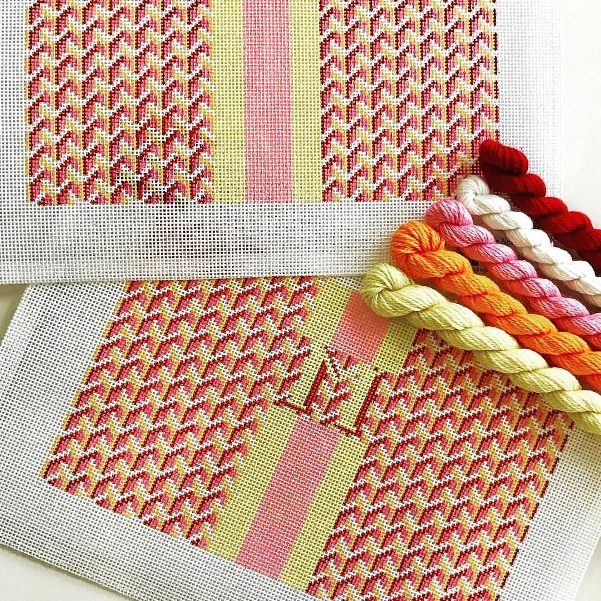Geometric repeat pattern needlepoint clutch bag design in orange and yellow