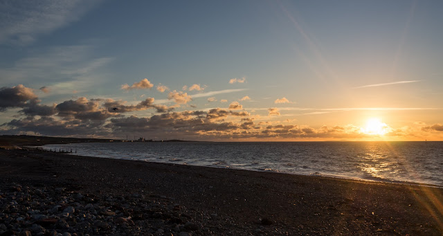 Photo of the sun going down over Grasslot shore at Maryport