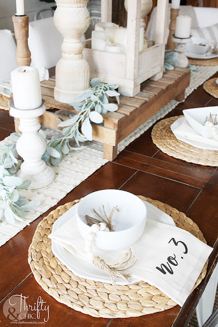 place setting on wood table with place setting