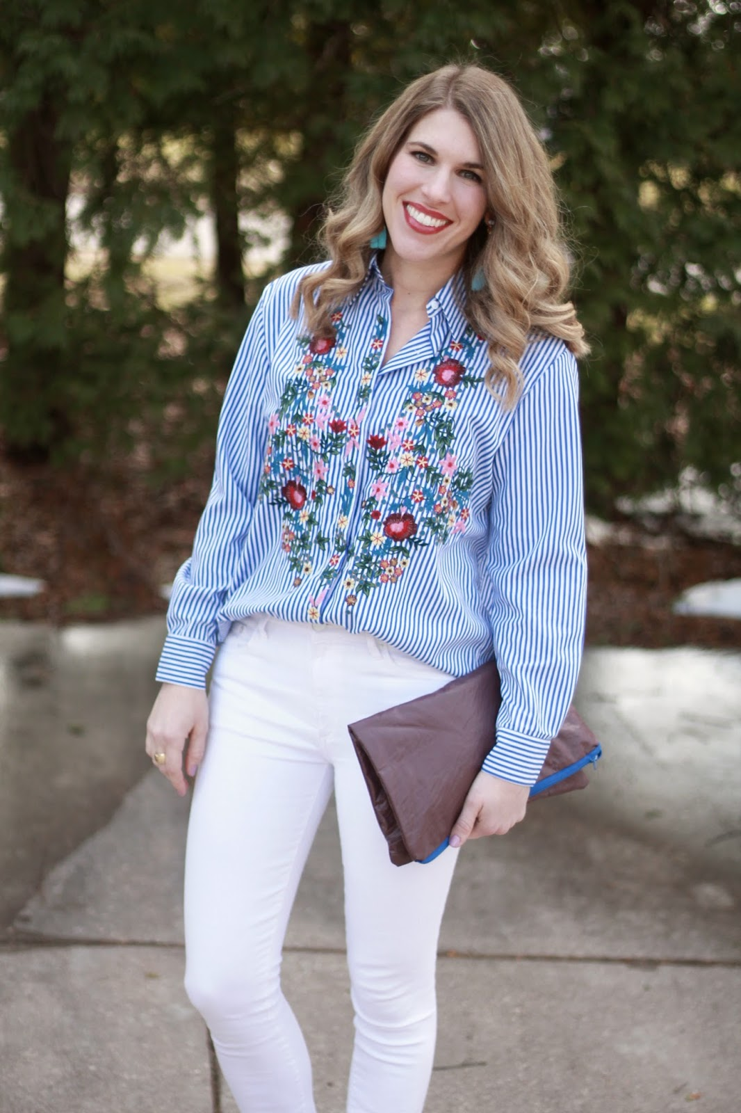 embroidered striped button up, white jeans, turquoise tassel earrings, burgundy clutch, nude heels
