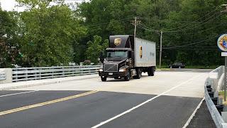 Truck going over Melanie Lane Bridge